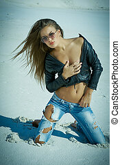Pert girl - Tanned beautiful girl in jeans and a leather...