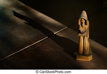 Wooden Statue of St. Francis in Afternoon Light with Shadow