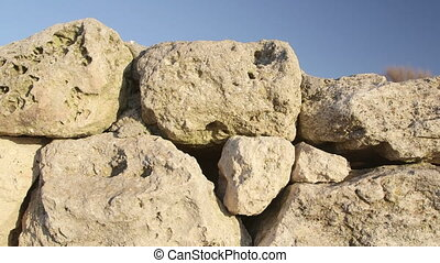 Dolly: Stone wall of ancient ruins at archaeological site -...