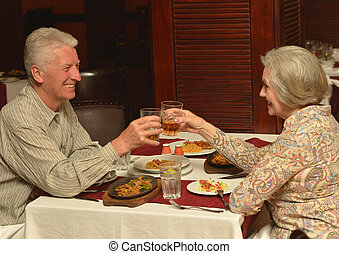 couple having a dinner - Senior couple having a dinner at...