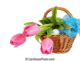 Easter eggs with tulips in wicker basket and blue loop...