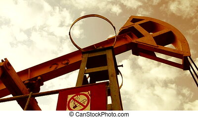 Pumpjack pumping oil from well - symbol of the oil industry
