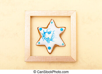 Christmas gingerbread cake star with icing and decoration in frame