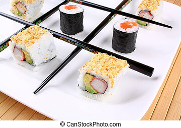 Tic tac toe play with sushi and chopsticks, close up