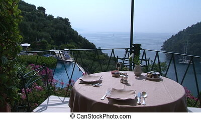 Table set for breakfast in hotel with amazing view on the...
