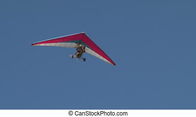 Motorized hang glider flying in the sky