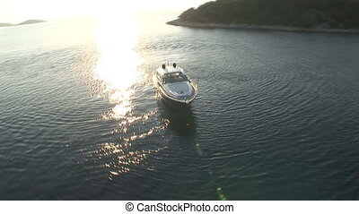 Boat staying close to the coast - Aerial view of luxury boat...
