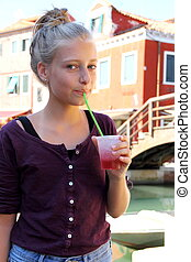 Happy girl with red slush drink