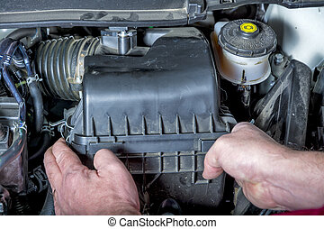 Automobile engine compartment - Air cleaner compartment in a...