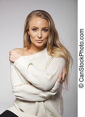 Cute blonde model in oversized sweater