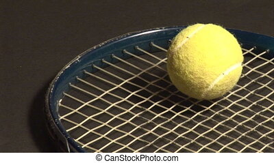Racket of tennis with ball