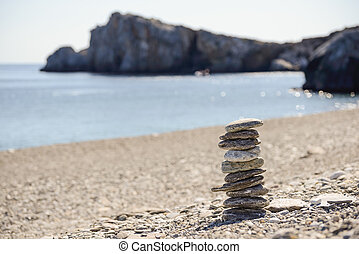 Pebbles in balancing on the beach - Pebbles in balancing on...