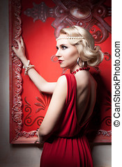 Fashion woman red dress in vintage room Professional make up...