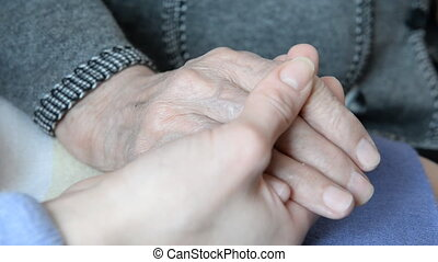 Hand in hand. Hand of an elderly w