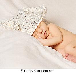 baby newborn portrait, kid sleeping in hat on white background