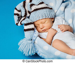 baby newborn portrait, kid sleeping in hat on blue...
