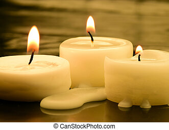 candles - three small tea lights in the dark