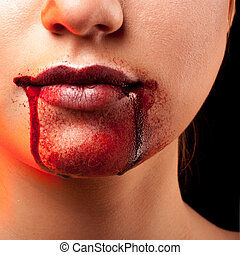 Closeup of Red lips of a young girl, with blood flowing by