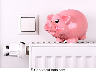 Pink piggy bank jump, saving electricity and heating costs,...
