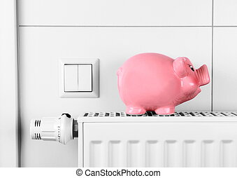 Pink piggy bank saving not electricity and heating costs,...