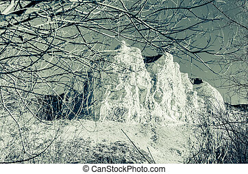 mountains rock view with sky. Trees around. Infrared photo