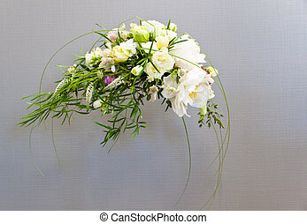 Bridal bouquet with peony and roses decorated with greens on...