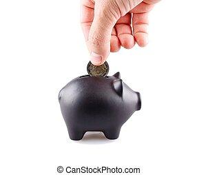 Black piggy bank - Coin thrown into a black piggy bank