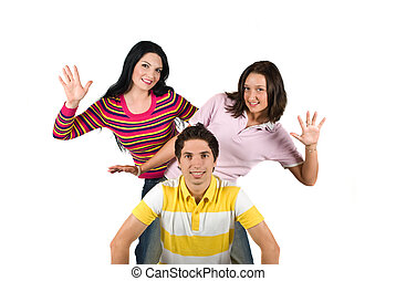 Playful young people - Three young playful friends standing...