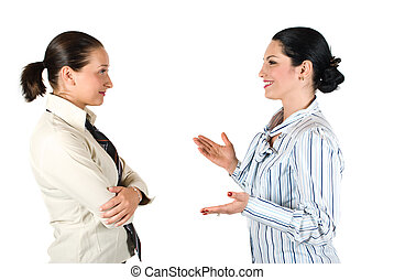 Business woman conversation - Two cheerful businesswoman...