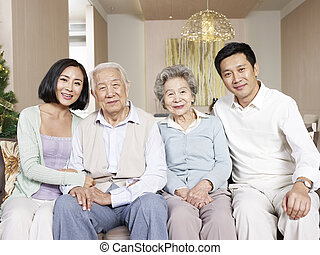 asian family - home portrait of a happy asian family