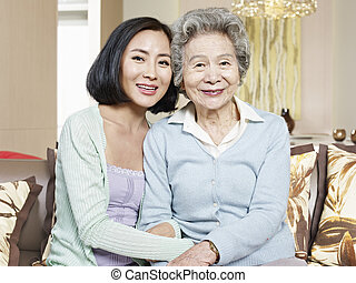 mother and adult daughter - asian mother and adult daughter...