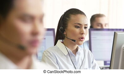 Online customer service - Young attractive assistants...