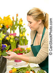 Florist arrange spring flowers colorful potted narcissus,...