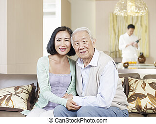 senior father and adult daughter - home portrait of asian...