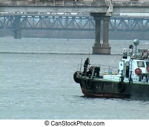 boat on the river - small boat with ukrainian flag turn near...