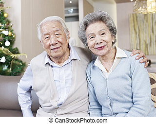 senior couple - home portrait of senior asian couple smiling