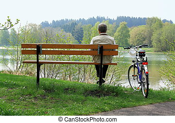 Mature man sitting relaxing after cycling
