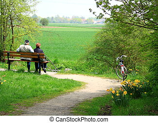 Mature couple sitting relaxing after cycling