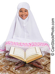 Young Muslim Girl Reading Al Quran - Young Asian Muslim girl...