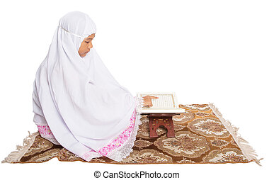 Young Muslim Girl Reading Al Quran - Young Asian Muslim girl...