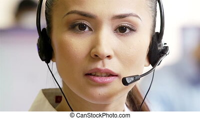 Receptionist with head-set - An attractive Asian girl...