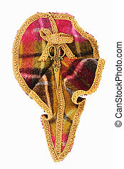 Brooch with beads and fabric braid on white background