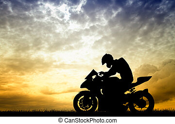 motorcyclist at sunset - illustration of motorcyclist at...