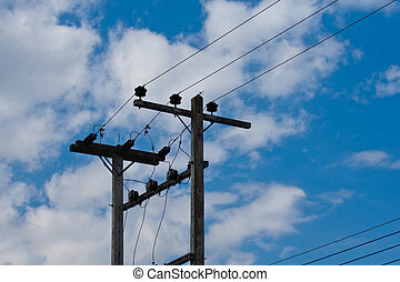 Electric line - Old electric line and blue sky with white...