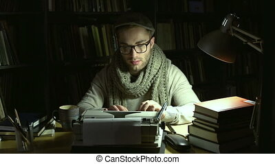 Creation - A writer typing his piece of art, crumpling and...