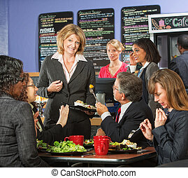 Apologetic Cafe Owner - Restaurant owner with group of...