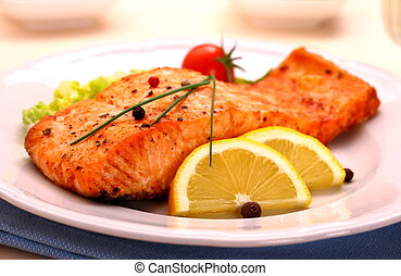 Grilled salmon filet and vegetables, close up