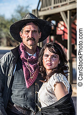Gruff Man and Woman - Portrait of an old west woman and...