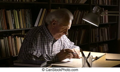 Writing out data - A gray-haired man copying data from the...