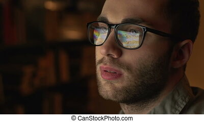 Working, not sleeping - A handsome man in eyeglasses in...
